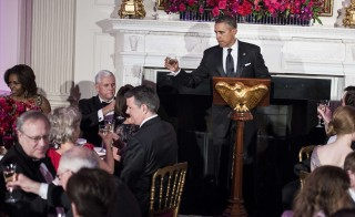 President Obama makes a toast during the 2014 Governors Dinner in the State Dining Room of the White House Sunday. Photo by BRENDAN SMIALOWSKI/AFP/Getty Images
