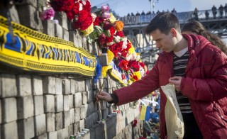 Arrest Warrant Issued For Former Ukrainian Leader As Square Becomes Shrine To Dead