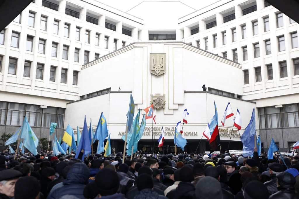The Crimean people and the supporters of Russia gather in front of the Parliament building in the Autonomous Republic of Crimea's capital Simferopol, Ukraine, on February 26, 2014. The Crimean people shout slogans for the unity of the country at the same time the Russian people shout slogans to support their country. Photo by Bulent Doruk/Anadolu Agency/Getty Images