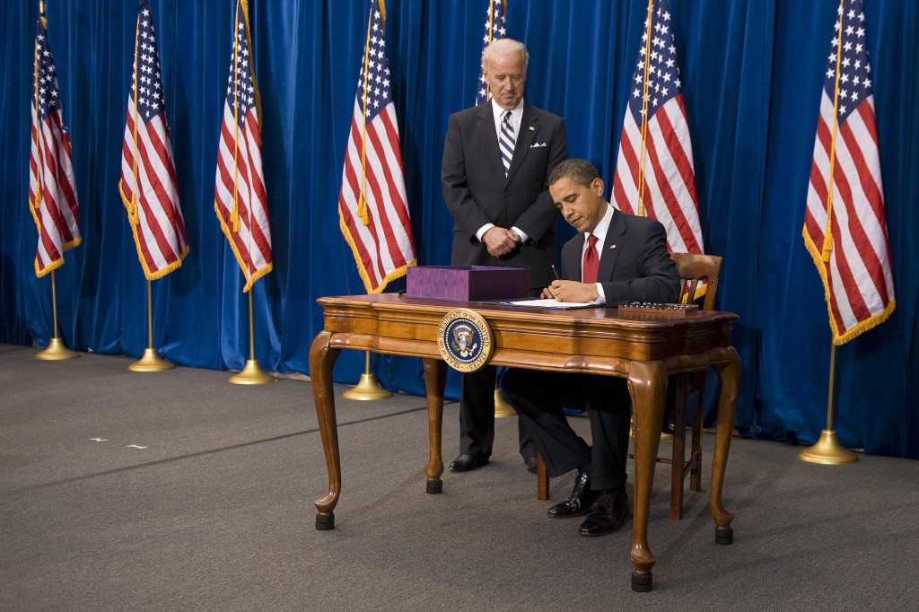 President Obama signs the American Recovery and Reinvestment Act at the Denver Museum of Nature and Science in Denver, Colorado, on February 17, 2009. Photo by Jim Watson/AFP/Getty Images