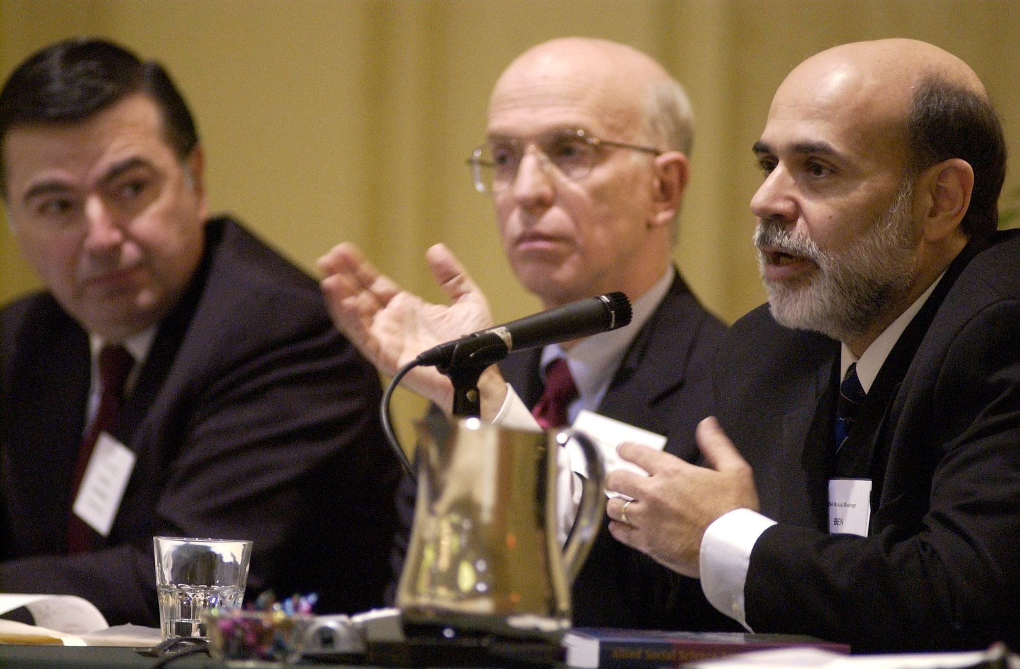 "Alan Blinder, center, thanks Ben Bernanke for a stronger Federal Reserve and more transparent central bank. Above, Blinder and Bernanke speak on a panel entitled ""Transition from Academic to Policymaker"" during the Allied Social Sciences Associations meeting in 2005. Photo by Mike Mergen/Bloomberg News via Getty Images."