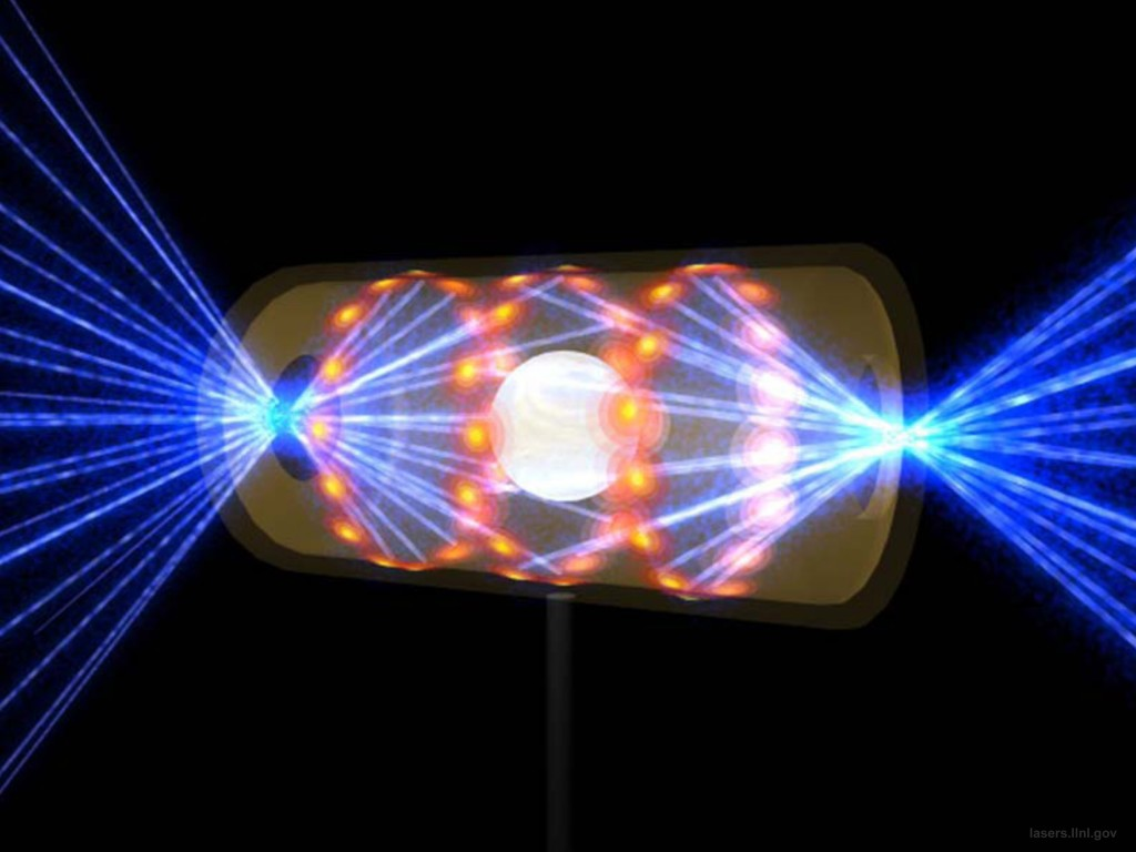 An artist's rendering laser beams entering a target capsule through openings on either end. The beams compress and heat the tiny drum inside to the necessary conditions for nuclear fusion to occur. Photo by Lawrence Livermore National Laboratory