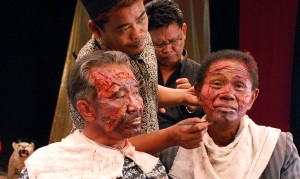 Anwar Congo (right) has his makeup done for a scene in