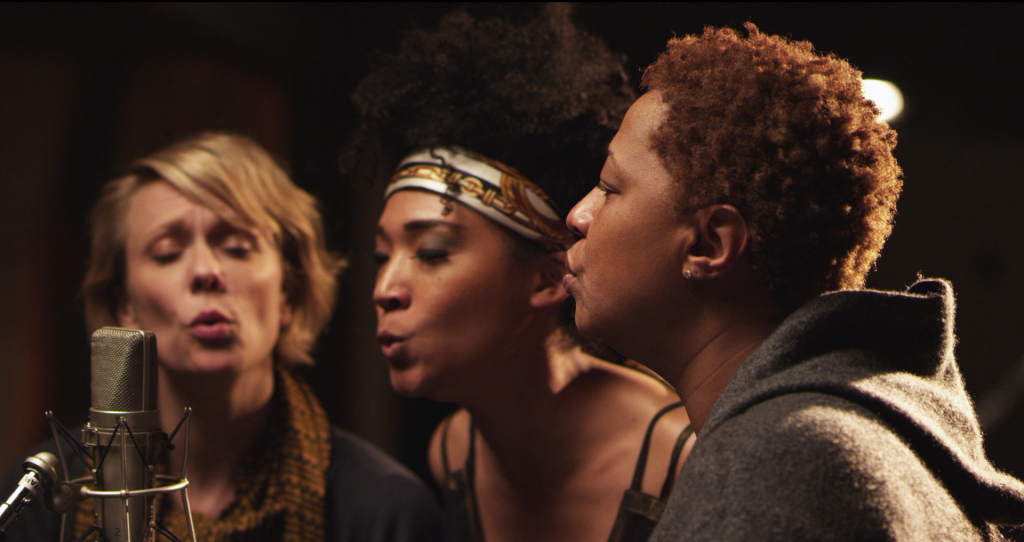 "Jo Lawry, Judith Hill and Lisa Fischer singing back-up in ""20 Feet From Stardom."" Courtesy: RADiUS-TWC"