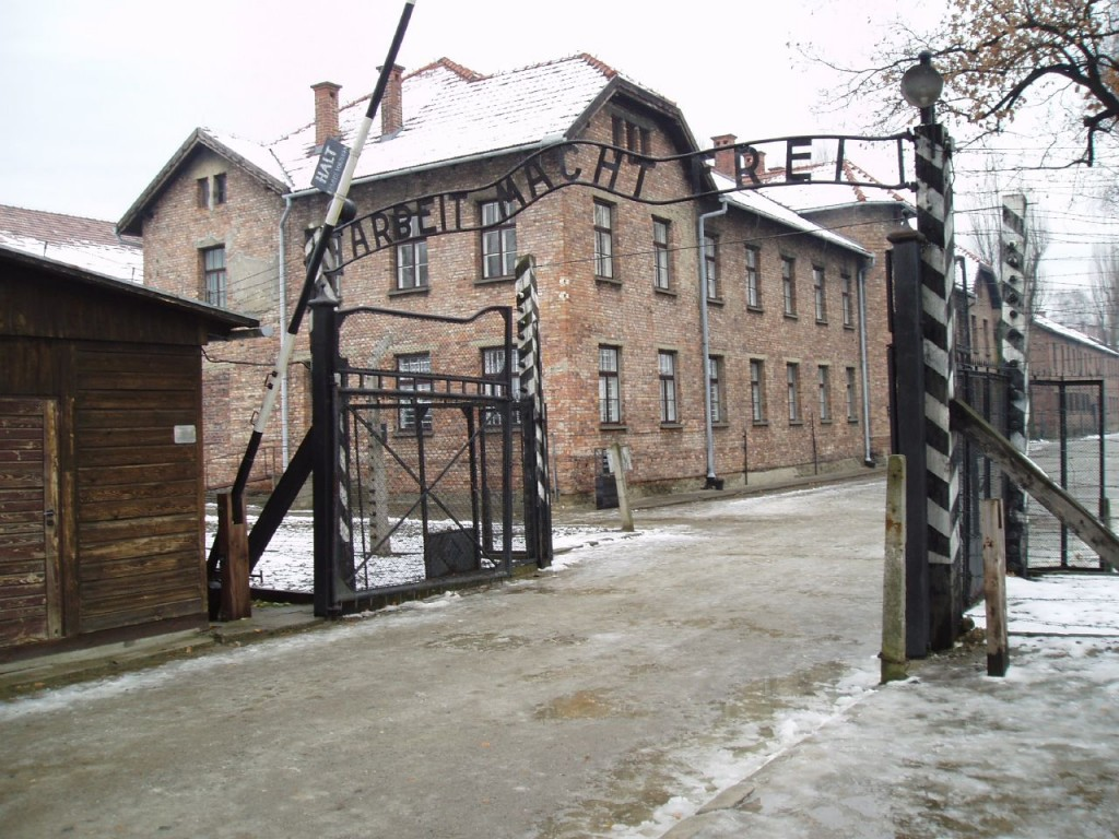 "The gates of Auschwitz read, ""Work will free you."" Seventy-four years after the first prisoners were deported to the Nazi-era death camp, prosecutors continue to arrest suspected former guards for their alleged participation in the death of at least 1.1 million people during World War II. Photo by Tulio Bertorini/Flickr"