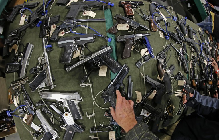 People check out a hundreds of hand guns on a table at the Rocky Mountain Gun Show in Sandy, Utah Wednesday, January 5, 2013. Photo by  George Frey/Bloomberg via Getty Images
