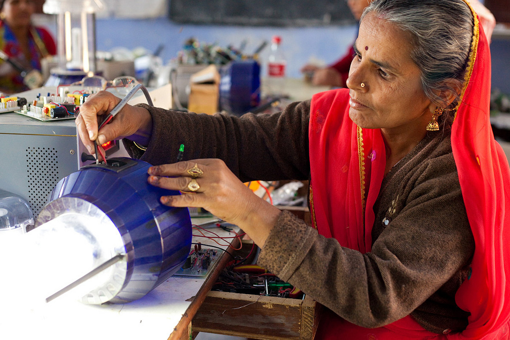 A solar engineer trainer at Barefoot College in Rajasthan, India demonstrates how to build a solar light. The U.S. criticized India for protecting its domestic solar industry at the expense of U.S. manufacturers. Photo by UN Women Gallery.