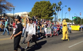 Students march in the Martin Luther King Jr. parade in Mesa, Ariz., to support A Ban Against Neglect, which helps mothers in Ghana. Photo courtesy of New Global Citizens