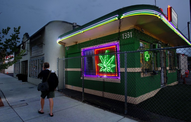 A pedestrians walks past the Little Green Pharmacy medical cannabis dispensary in Denver, Colorado, on Tuesday, August 2, 2011. Photo by Randall Benton/Sacramento Bee/MCT via Getty Images.