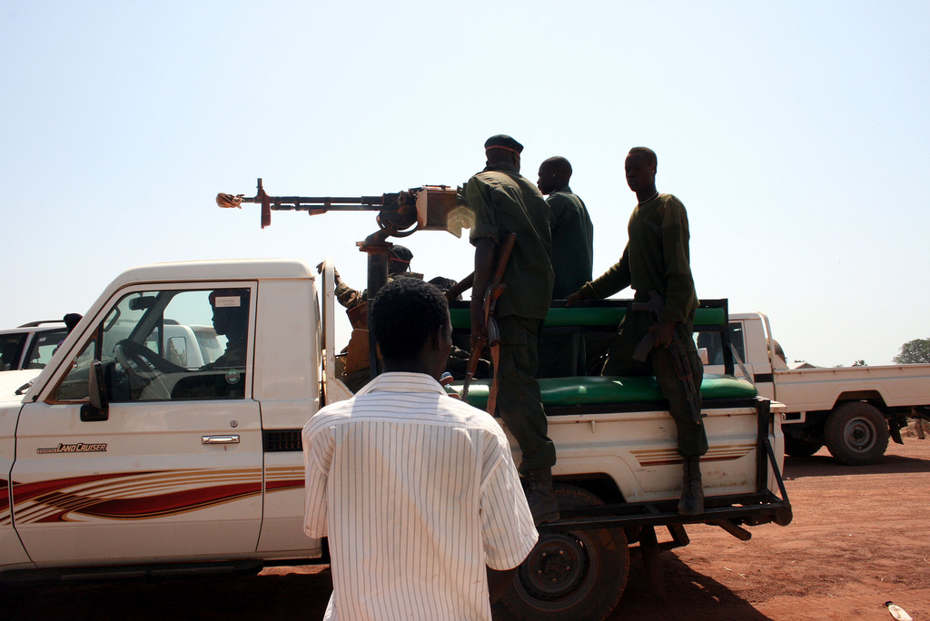Paramilitary members ride in the back of a pickup truck in Warab state in southern Sudan. Photo by Larisa Epatko