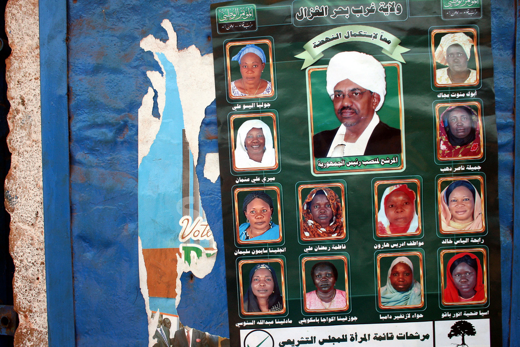 A 2010 campaign poster for the National Congress Party showing all female candidates with President Omar al-Bashir as the centerpiece. Photo by Larisa Epatko