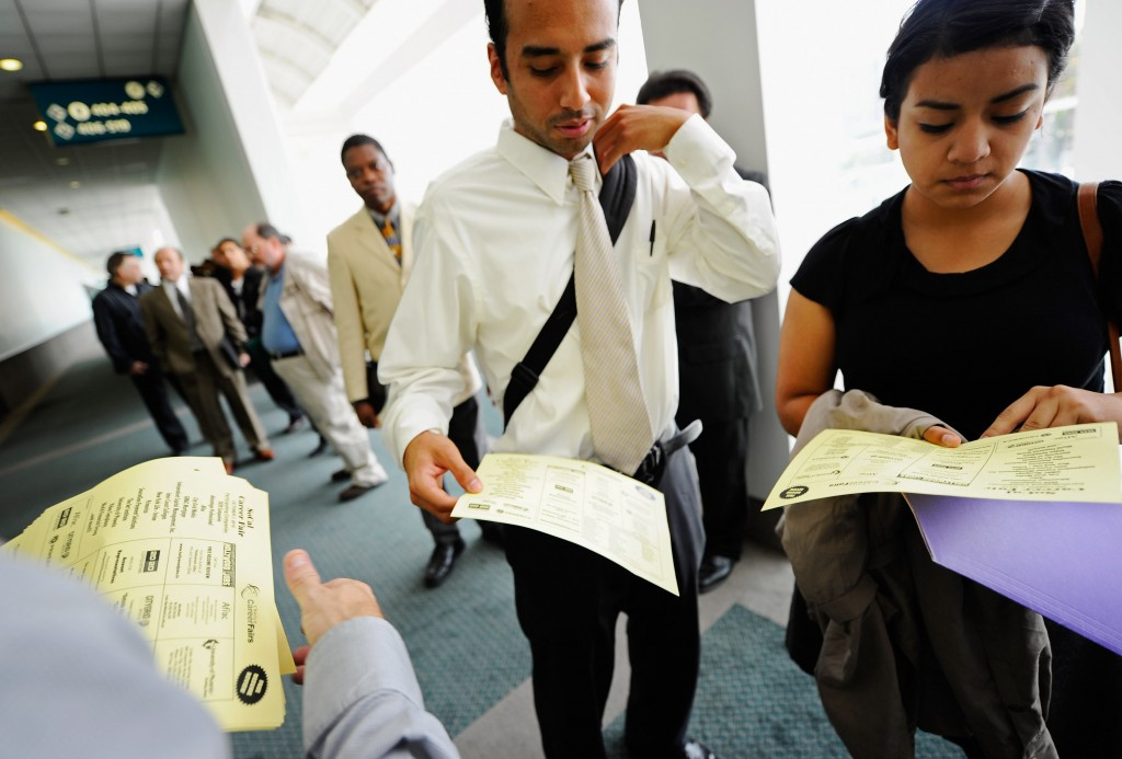 People wait in line to enter Choice Career Fairs job fair at a convention center in Los Angeles, California. The number of first-time jobless claims rose more than expected last week. Photo by Kevork Djansezian/Getty Images