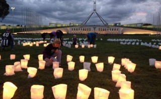 "A candle display outside Parliament House in Canberra spells out ""It's Lights Out For The Reef"", as people take a stand for the Great Barrier Reef. Image © WWF Australia"
