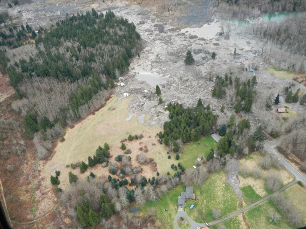 In this handout from the Washington State Department of Transportation, a mudslide on Saturday buried a mile of State Route 530, demolished 30 homes and killed at least eight people in a rural community near Oso, Wash. Photo by WSDOT