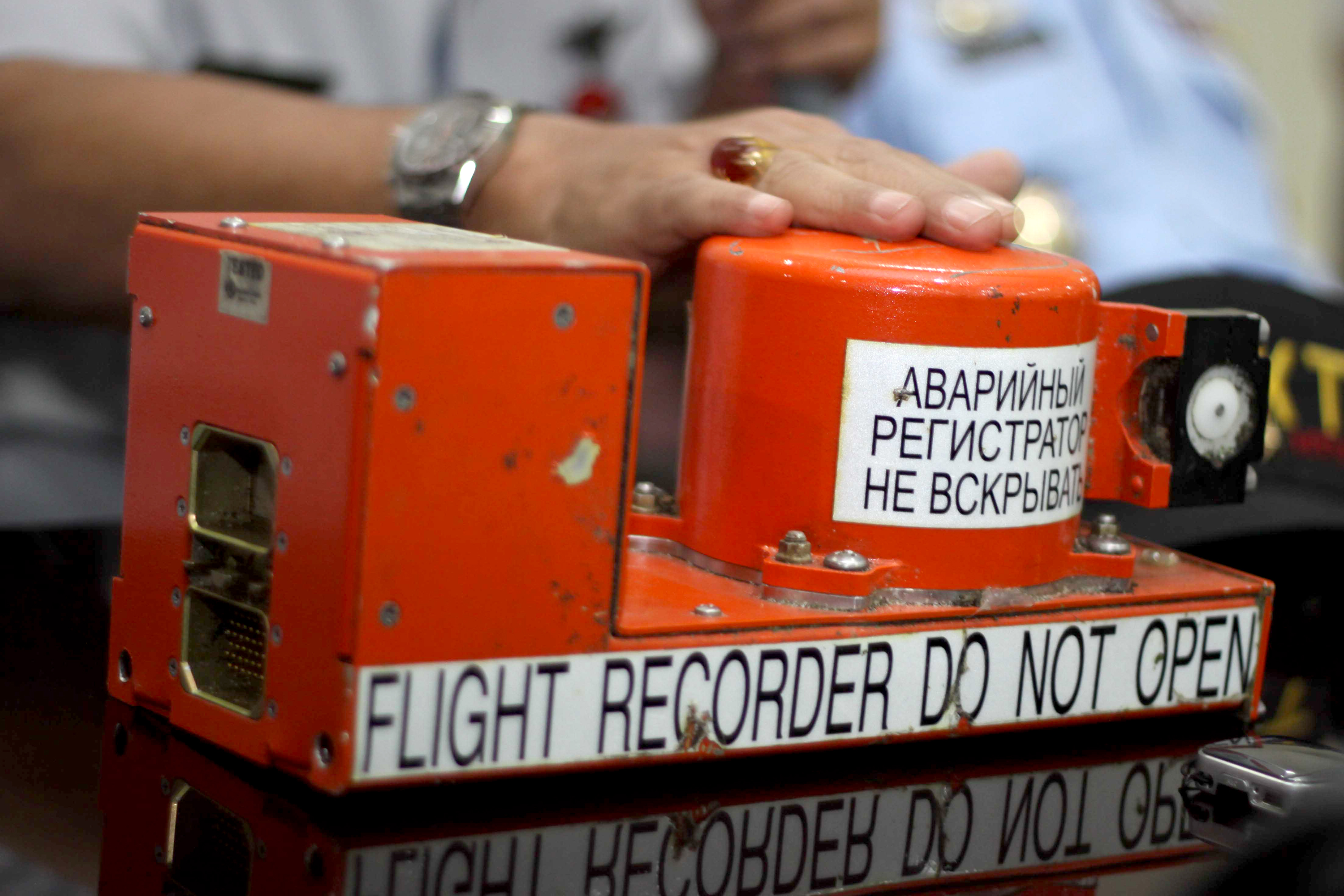 The flight data recorder, or black box of a crashed Russian passenger jet is displayed during a press conference in Jakarta on May 31, 2012. Indonesian searchers  found the second 'black box' of the Sukhoi Superjet 100 three weeks after slammed into the 7,200-foot (2,200-metre) Mount Salak in western Java killing all 45 people on board. Photo by Jefri Tarigan/AFP/Getty Images.
