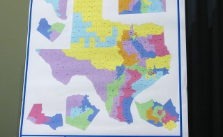 A 2003 map shows proposals to redistrict Texas. Photo by Jana Birchum/Getty Images