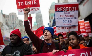 Protesters rally outside of a Wendy's in support of raising fast food wages from $7.25 per hour to $15 per hour on December 5, 2013 in New York City. Photo by Andrew Burton/Getty Images