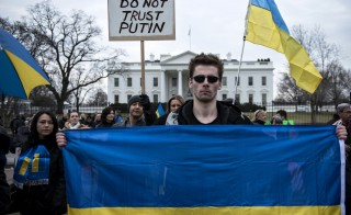 Ukrainian activists gather outside the White House on March 1, 2014 in Washington. Protesters gathered to rally against foreign involvement in the Ukrainian region of Crimea. AFP PHOTO/Brendan SMIALOWSKI (Photo credit should read BRENDAN SMIALOWSKI/AFP/Getty Images)
