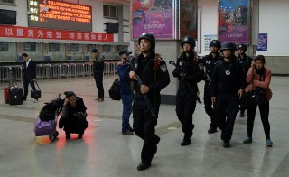 Chinese police remained on guard on Sunday at a train station in western China where knife-wielding attackers killed 29 people.