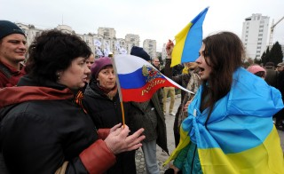 Pro-Russian and Pro-Ukrainian protestors argue at a rally supporting Kiev held in the Crimean city of Sevastopol on Sunday. Credit: Viktor Drachev/Getty
