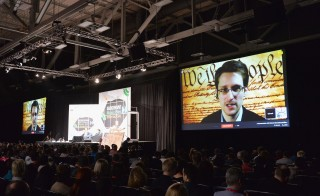 NSA whistleblower Edward Snowden speaks via videoconference at the 'Virtual Conversation With Edward Snowden' during the 2014 SXSW Music, Film + Interactive Festival at the Austin Convention Center on March 10, 2014 in Austin, Texas. Photo by Michael Buckner/Getty Images for SXSW