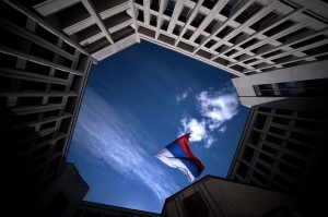 A Russian flag blows inside the entrance of Crimea's regional parliament building in Simferopol  on March 13, 2014. Photo by Filippo Monteforte/AFP/Getty Images