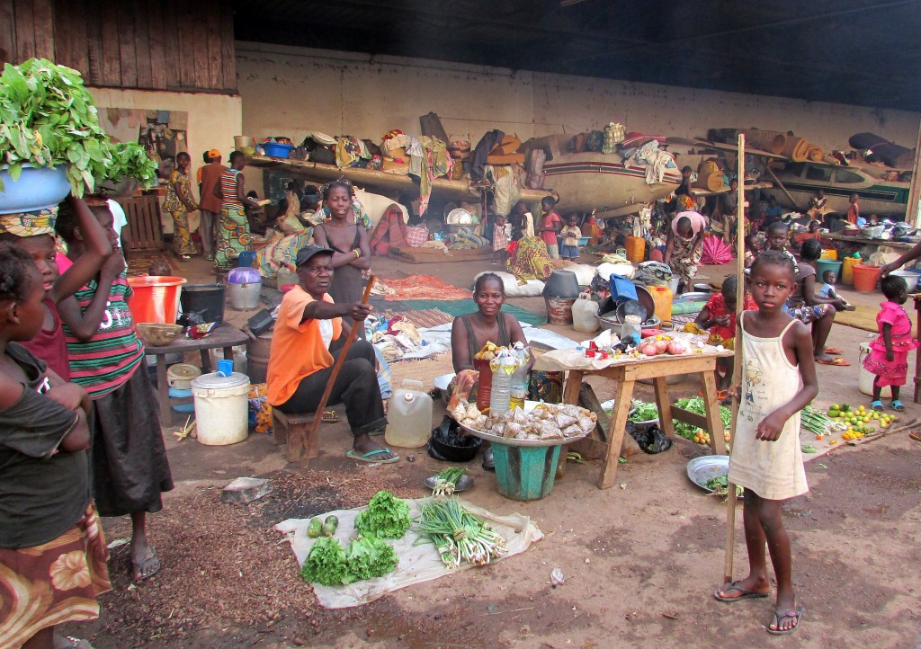 People sell goods inside a camp next to Bangui's airport in the Central African Republic on March 18, 2014. Photo by Pacome Pabamdji/AFP/Getty Images