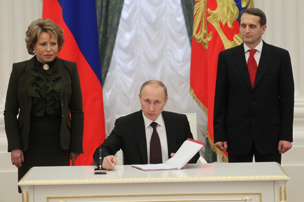 Russian President Vladimir Putin signs bills marking Crimea part of Russia. Russia's moves in Ukraine have Europe's leaders on edge. Photo by Sasha Mordovets/Getty Images