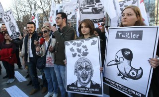 People hold placards as they protest against Turkey's Prime Minister Tayyip Erdogan after the government blocked access to Twitter in Ankara, on March 21, 2014. Photo by Adem Altan/AFP/Getty Images)