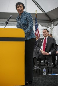 Councilmember and Mayoral candidate Muriel Bowser, left, makes remarks while incumbent Mayor Vincent Gray listens, right, at the Southwest Wharf project groundbreaking on March, 19, 2014 in Washington, DC. Photo by Bill O'Leary/The Washington Post via Getty Images.