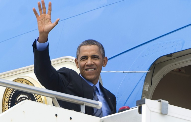 US President Barack Obama waves as he boards Air Force One  on March 28, 2014. Image by Saul Loeb/AFP/Getty Images