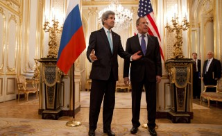 US Secretary of State John Kerry (L) gestures next to Russian Foreign Minister Sergey Lavrov (R) at the Russian Ambassador's Residence, in Paris, on March 30, 2014, as they are about discuss the situation in Ukraine. Kerry traveled to Paris for a last minute meeting with Lavrov. AFP PHOTO / POOL / JACQUELYN MARTIN        (Photo credit should read JACQUELYN MARTIN/AFP/Getty Images)