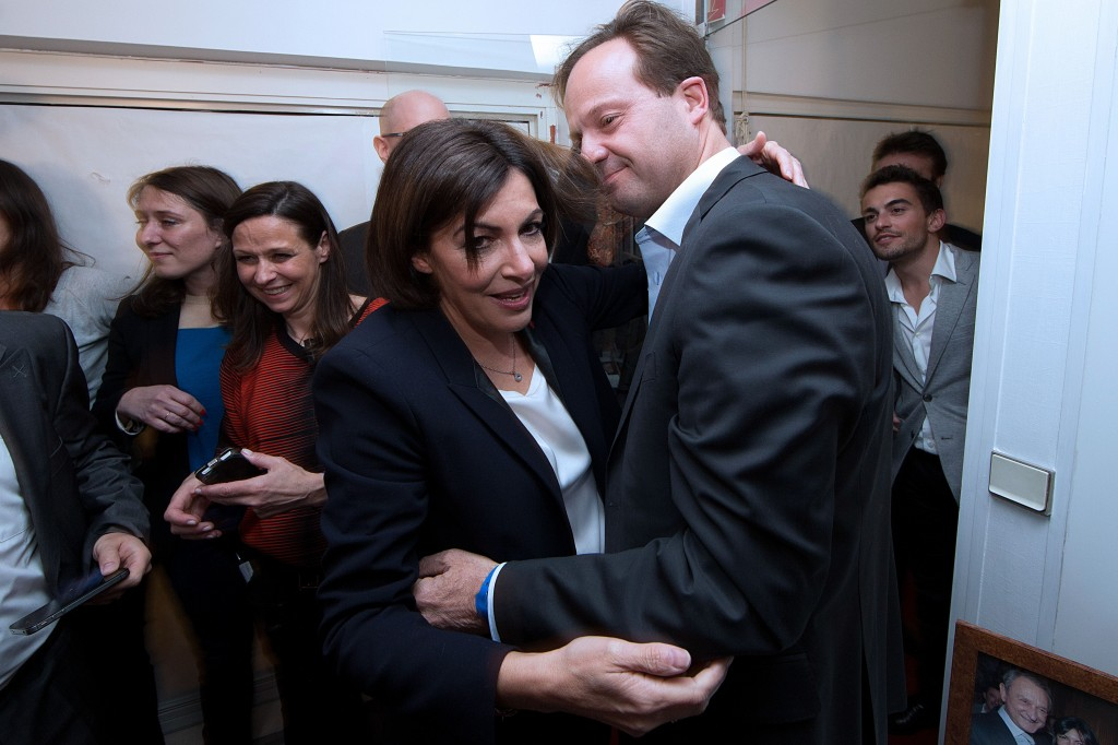 French Socialist party (PS) deputy mayor of Paris and candidate to the municipal elections in the French capital, Anne Hidalgo (C) hugs her husband Jean-Marc Germain after the announcement the results of the secound round of the French municipal elections, in her campaign headquarters in Paris, on March 30, 2014. Anne Hidalgo, the candidate of France's ruling Socialist Party, will be the first female mayor of Paris after winning municipal elections in the French capital on Sunday, exit polls indicated. AFP PHOTO / JOEL SAGET        (Photo credit should read JOEL SAGET/AFP/Getty Images)