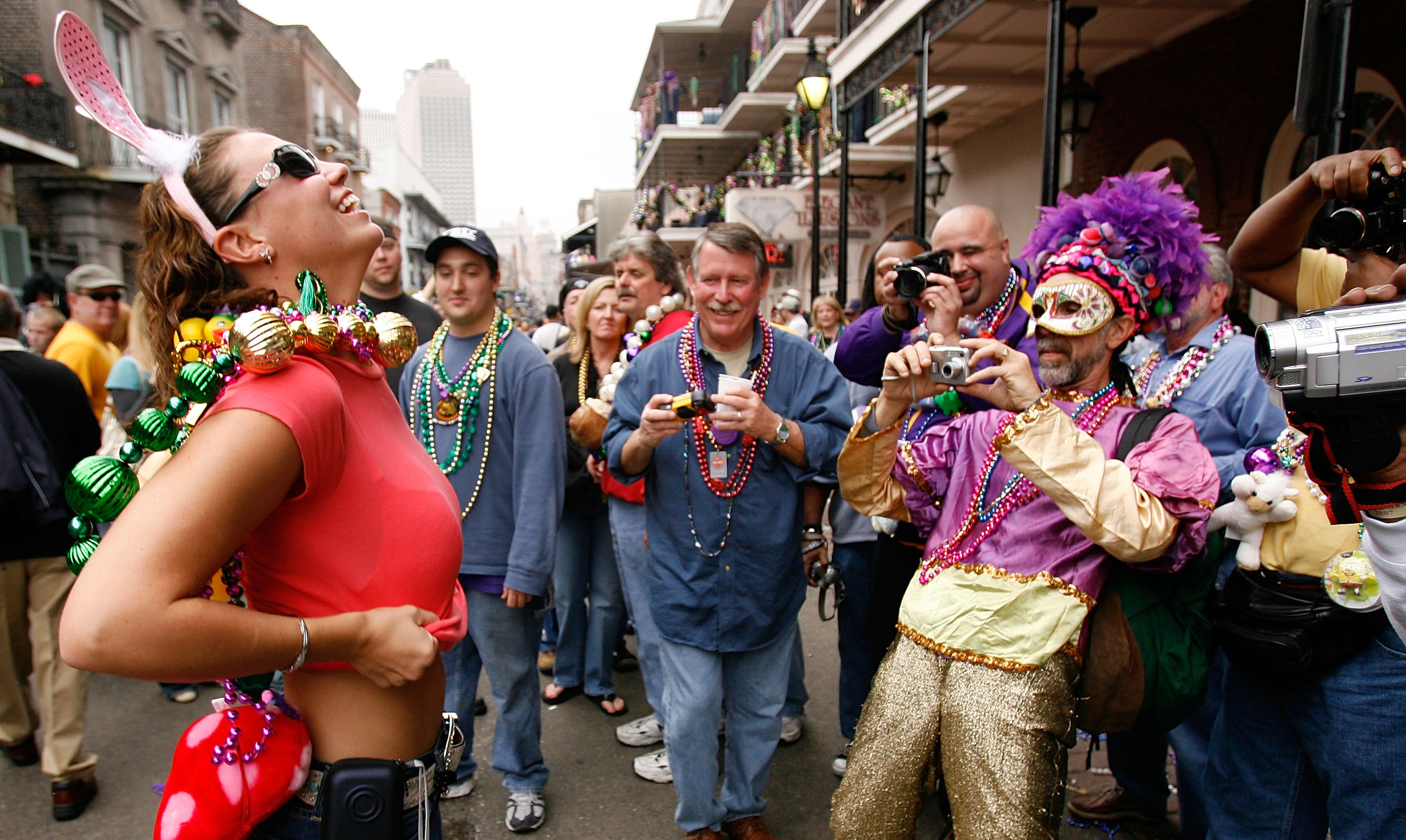 Revelers with cameras crowd Bourbon Street on February 20, 2007.