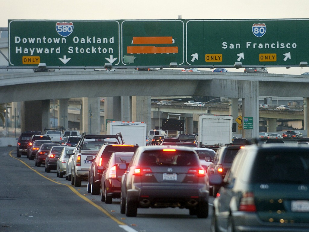 Drivers on Interstate 580 approach the MacArthur Maze interchange in heavy traffic near Oakland, California, in this 2007 file photo. President Barack Obama is set to announce an initiative to boost private-sector investment in the country's aging system of highways, bridges and transit systems. Photo by Noah Berger/AP