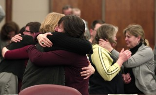 Same-sex couples hug after getting married in a group ceremony at the Oakland County Courthouse March 22, 2014, in Pontiac, Mich. On Friday, U.S. Attorney General Eric Holder said the U.S. will recognize those marriages despite Michigan Gov. Rick Snyder's decision not to grant those couples state benefits. Photo by Bill Pugliano/Getty Images