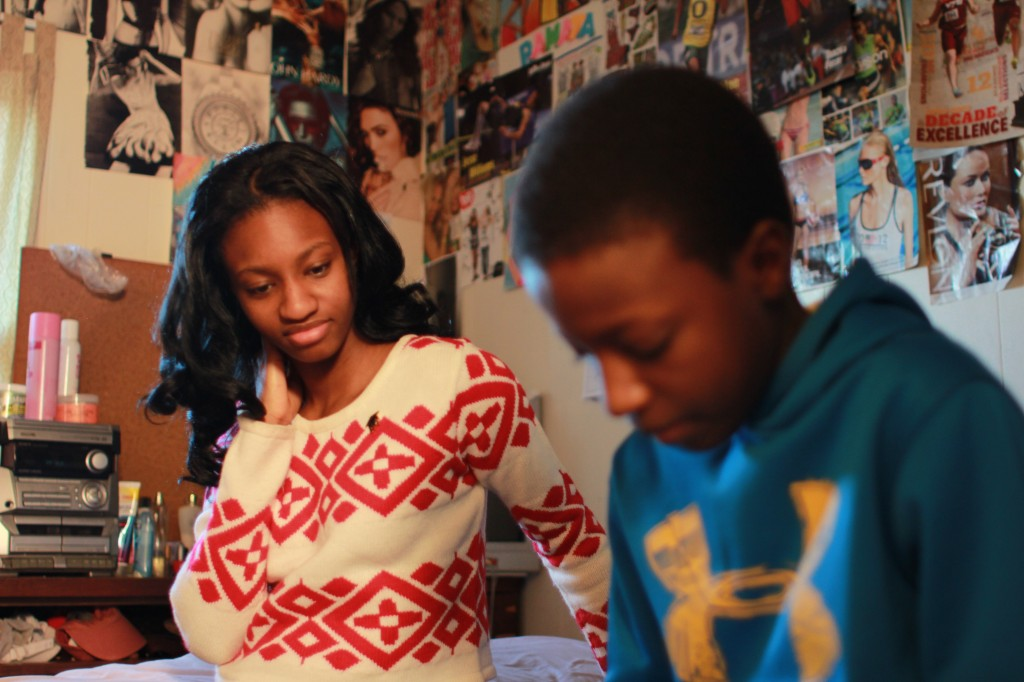 Ramata sits in her room in Baltimore with her brother Mohamed. Photo by Ruth Tam