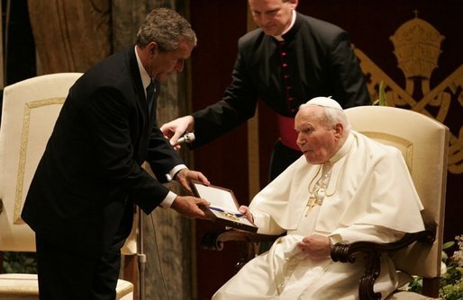 President George W. Bush awards the Presidential Medal of Freedom to Pope John Paul II. White House photo by Eric Draper