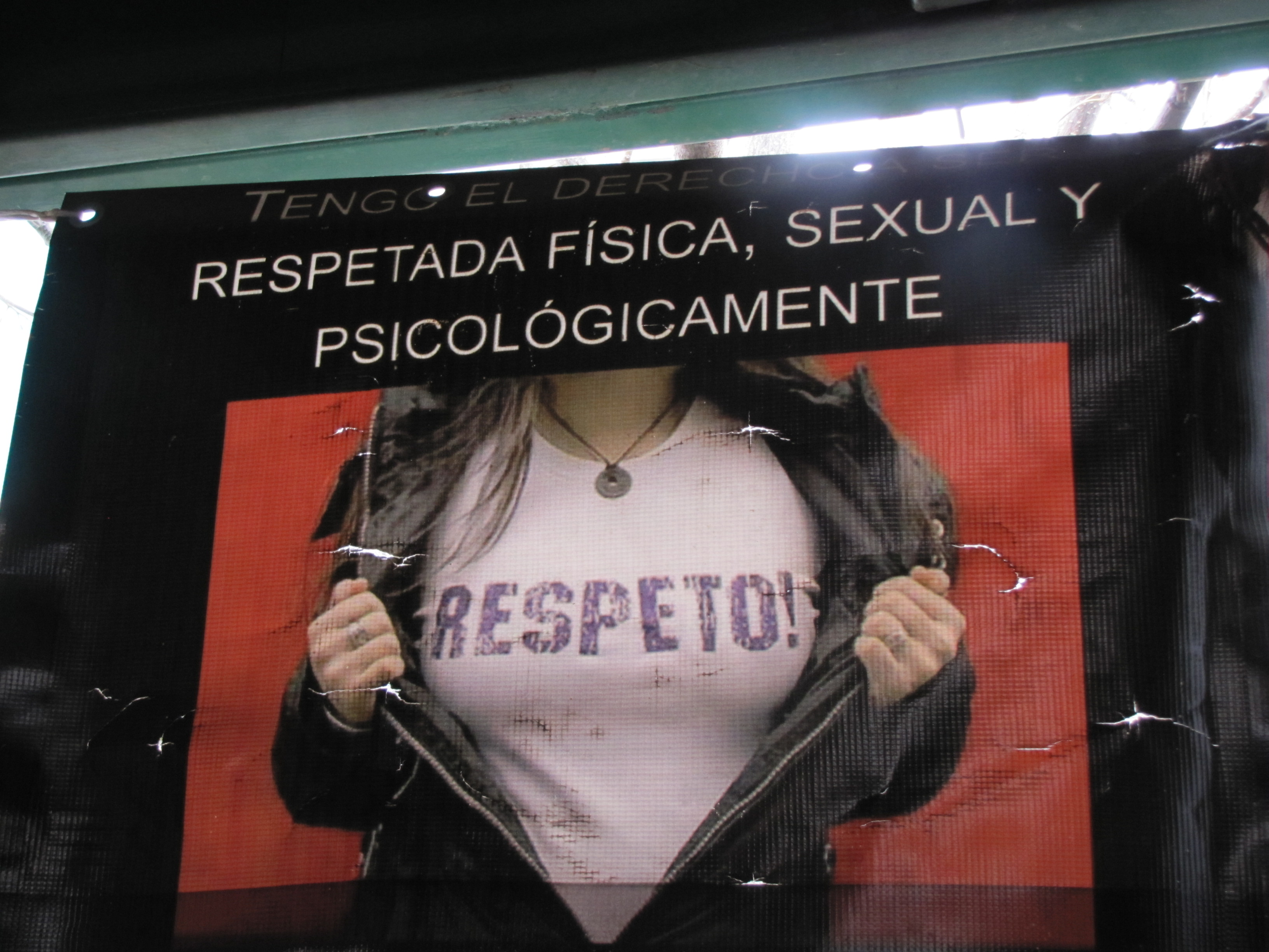 "A poster hanging in a migrant shelter in Nogales, Mexico. The text reads ""I have the right to be respected physically, sexually and psychologically,"" in Spanish. Photo by Jude Joffe-Block/Fronteras Desk."