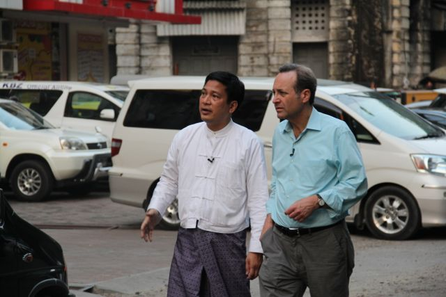 Thant Myint-U, director of the Yangon Heritage Trust, gives Jeffrey Brown a tour of colonial buildings, which are threatened by large-scale development. Photo by Mary Jo Brooks/PBS NewsHour