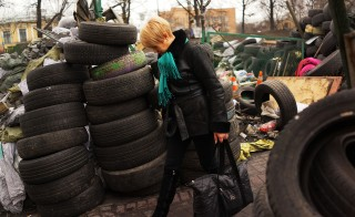 Former IMF chief economist Simon Johnson is skeptical that an IMF loan package will solve Ukraine's problems. Above, a woman walks through Maidan Square, the site of months of often violent protest that led to the ouster of former Ukrainian president Viktor Yanukovich.  Photo by Spencer Platt/Getty Images.