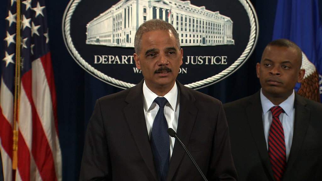 Attorney General Eric Holder announced that Toyota was to pay a $1.2 billion as part of a settlement that concludes a four-year criminal probe into the misleading actions of the world's largest automaker that left Americans' safety compromised. Video still by PBS NewsHour