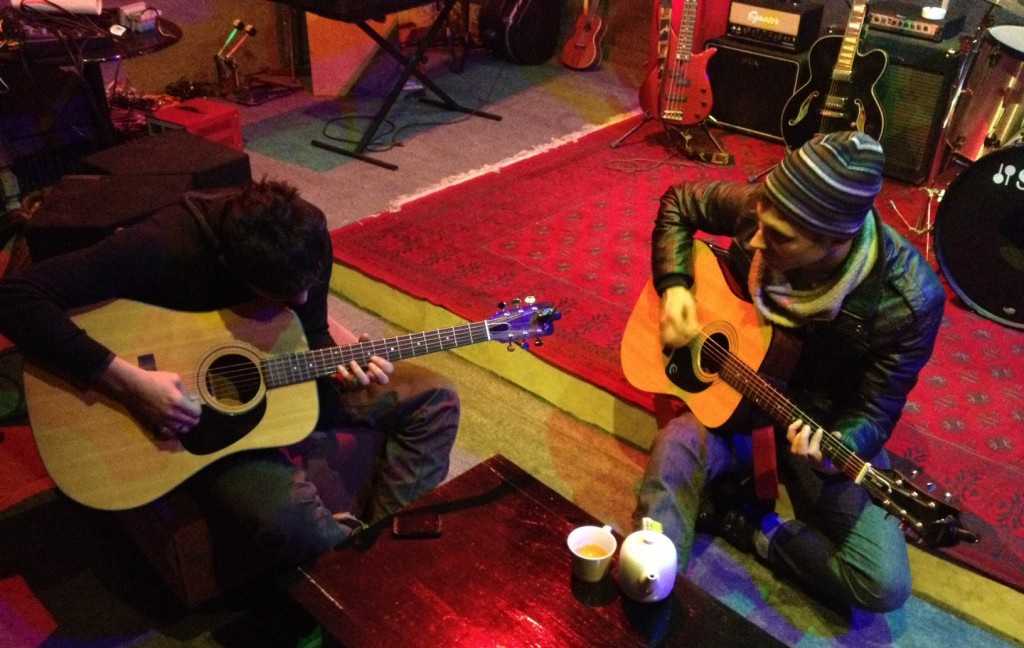 Portland musician Michael Lewis (right) teaches guitar to an Afghan student. Photo courtesy of Sound Studies Projects