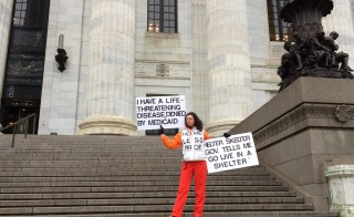 Mary-Faith Cerasoli protests the conditions of adjunct professors outside the New York State Department of Education in Albany on Friday, March 28. Photo by Lee Koromvokis.