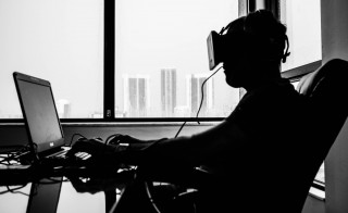 Facebook has bought Oculus VR, the maker of the virtual reality headset, for $2 billion. Photo by Flickr user Sergey Galyonkin.