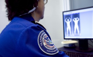 TSA Supervisor Patricia Granese reviews an image collected during a demonstration of the Rapiscan Backscatter advanced imaging technology machine at Logan International airport in Boston, Massachusetts, U.S., on Friday, March 5, 2010.