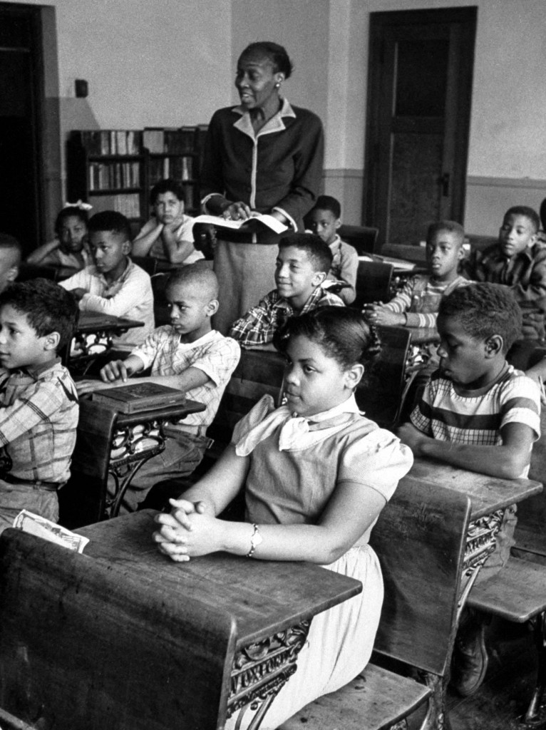 Linda Brown sitting in her segregated classroom at the Monroe School re case brought before Supreme Court on her behalf resulting in decision to make school segregation illegal. Photo by Carl Iwasaki//Time Life Pictures/Getty Images