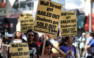 Student activists demonstrate against the rising costs of student loans in Los Angeles in 2012. Photo by David McNew/Getty Images