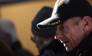 "A homeless U.S. military veteran stands in line for free winter clothing at a ""Stand Down"" event hosted by the Department of Veterans Affairs on Nov. 3, 2011 in Denver, Colorado. Photo by John Moore/Getty Images"
