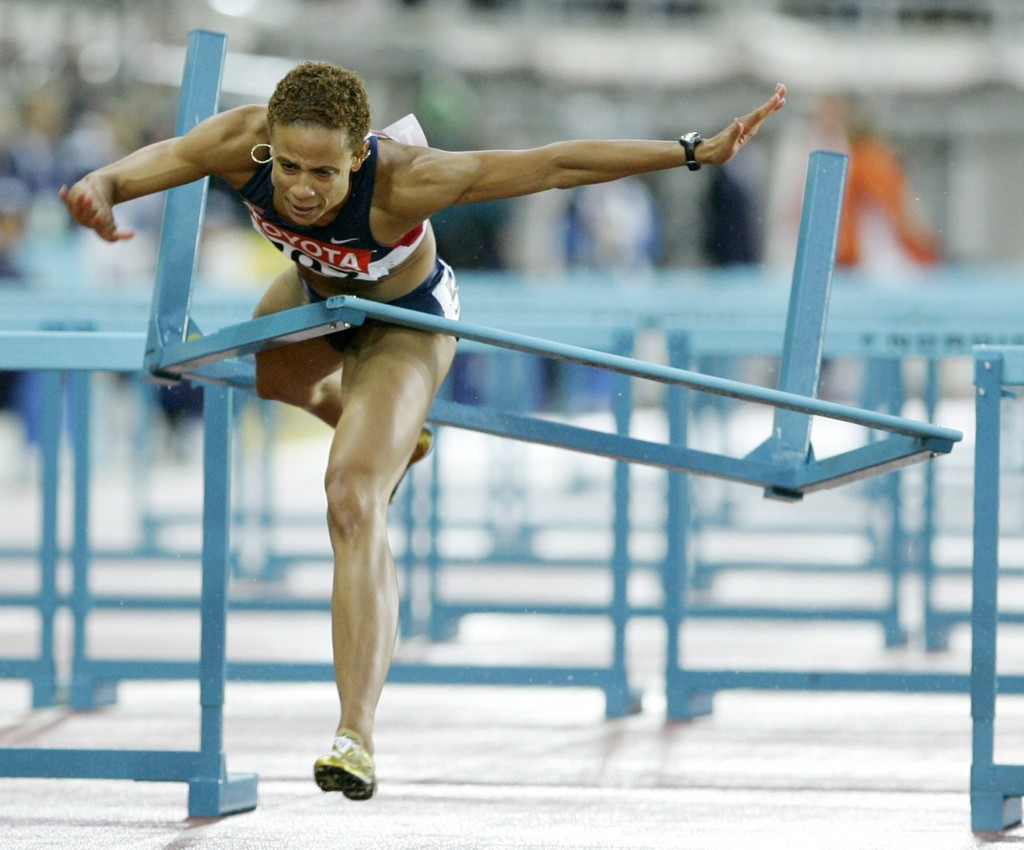 Joanna Hayes of the US collides with a hurdle, during the final of the Women's 100 meter hurdles at the World Athletics Championships in Helsinki, Thursday Aug. 11, 2005. Photo by Anja Niedringhaus/AP